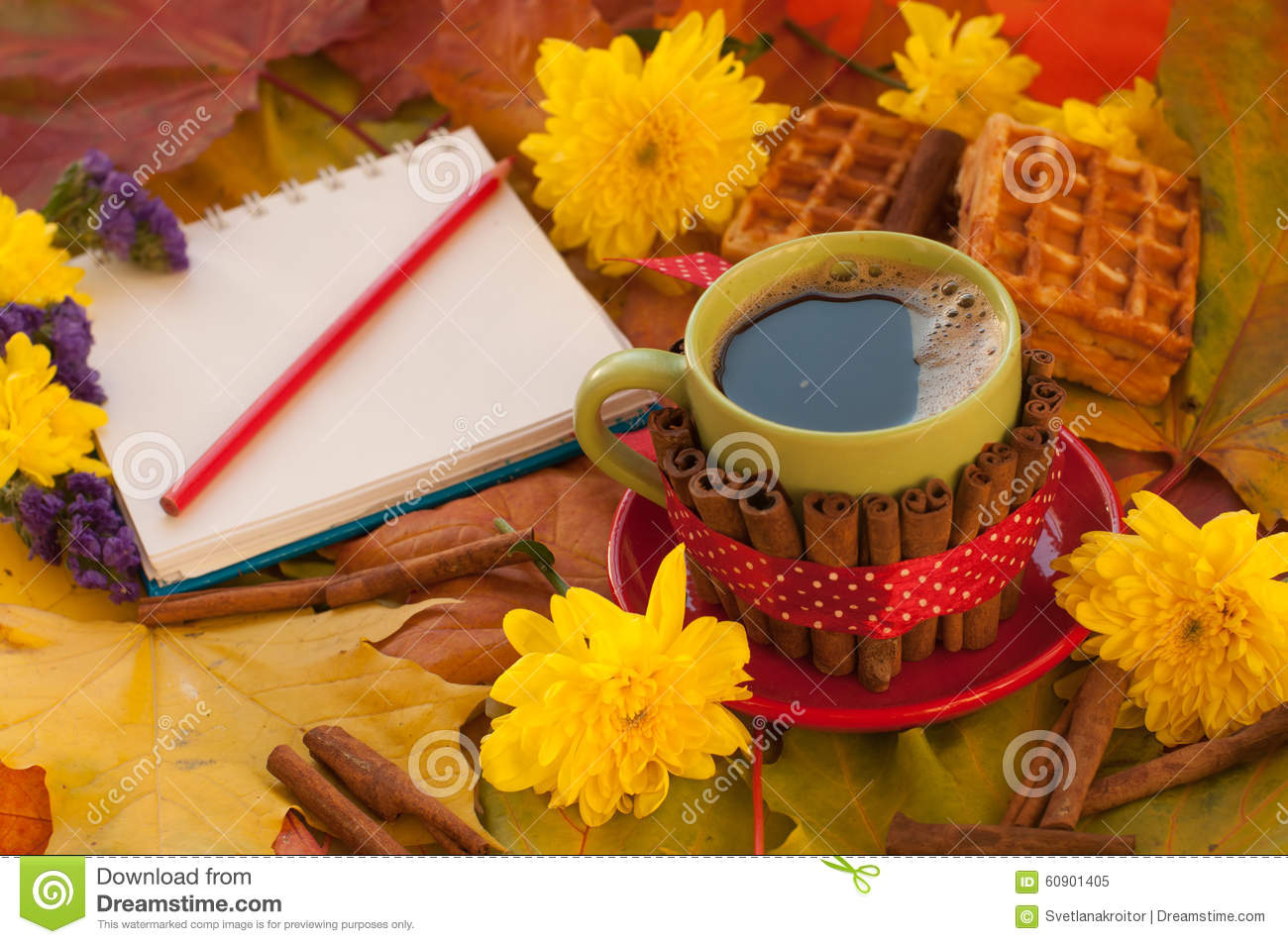 a cup of coffee a notebook homemade waffles maple leaves
