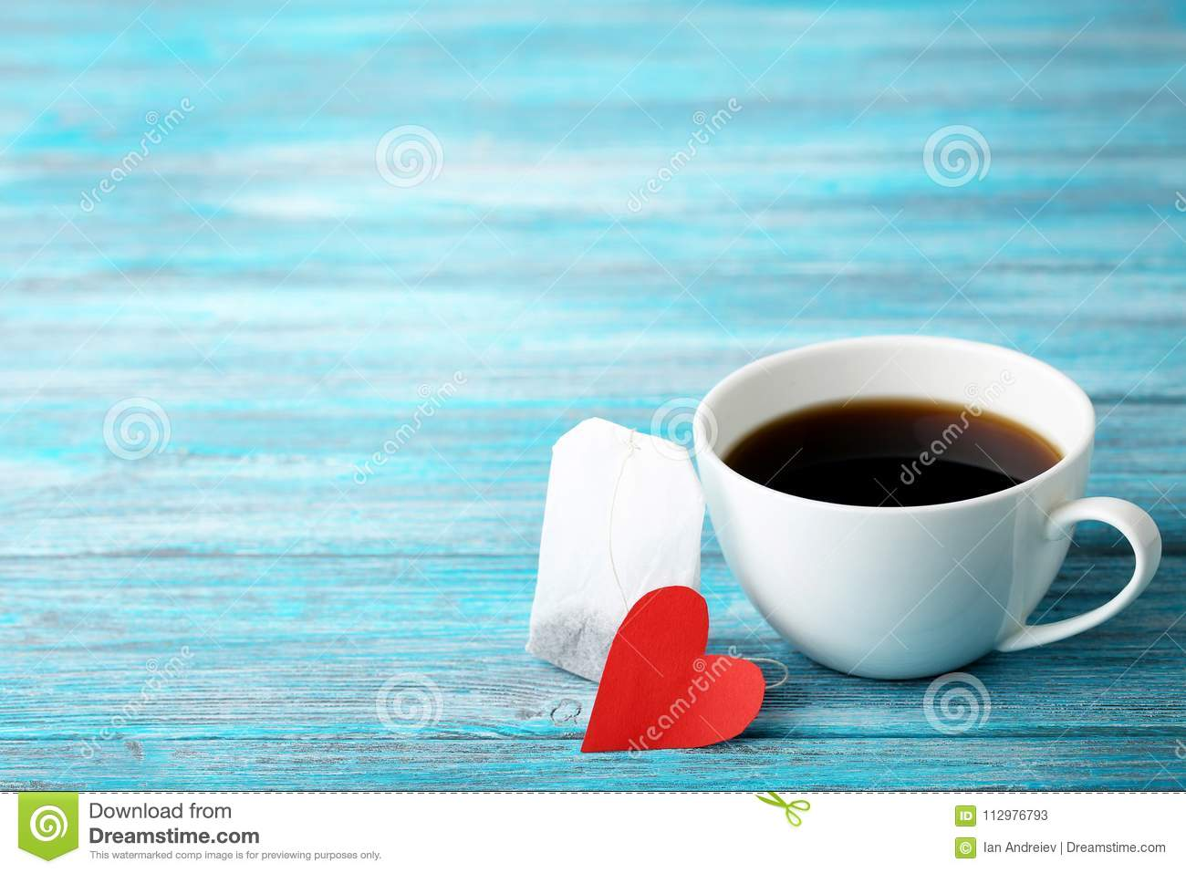 Cup of coffee with red heart