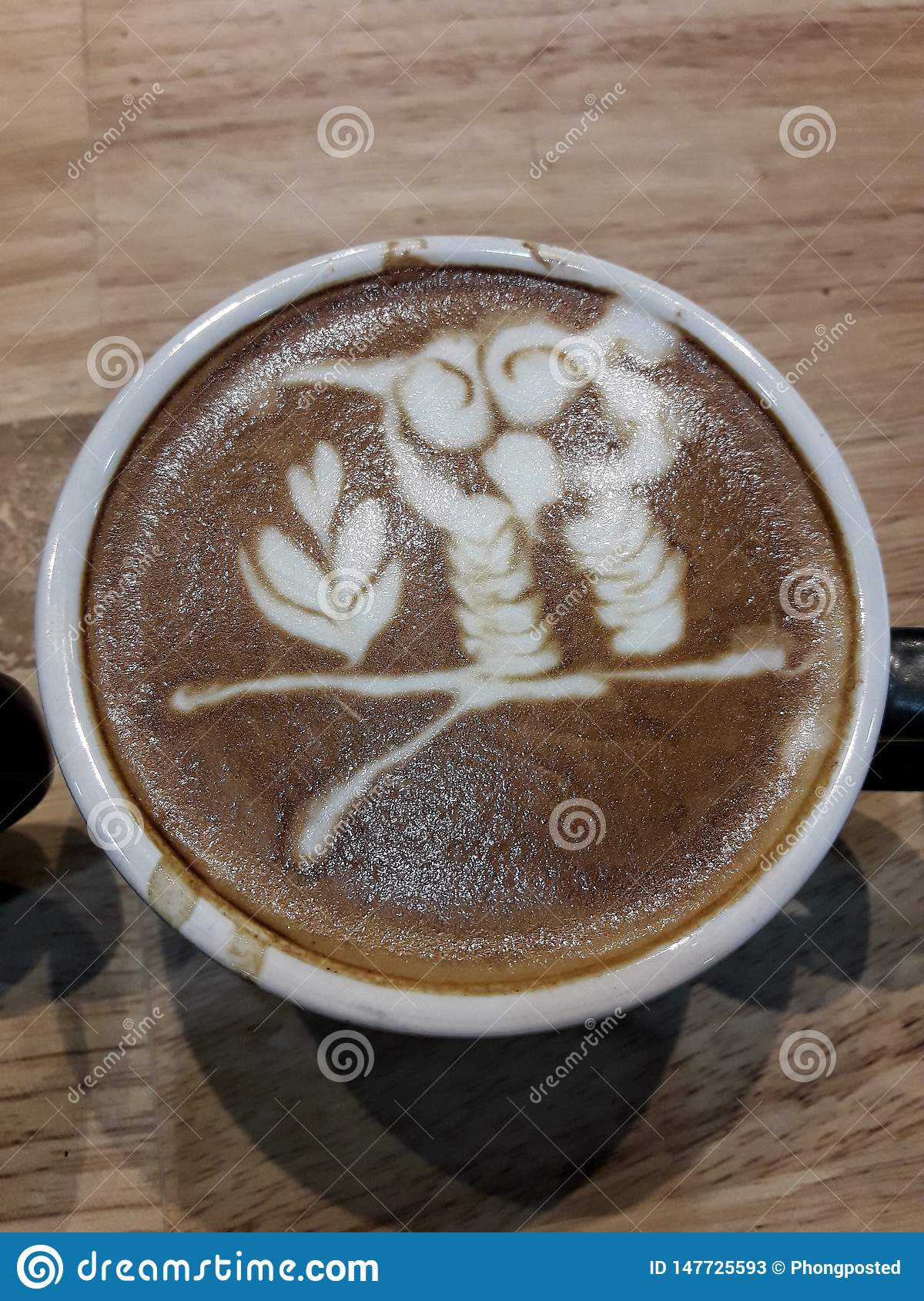 Cup of coffee with shadow on wood table