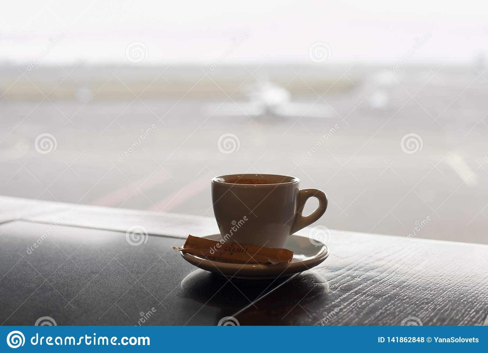 Cup of coffee on the table in airport cafe.