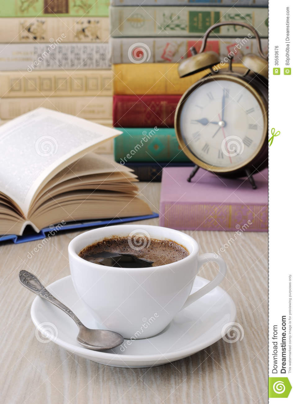A Cup Of Coffee On A Table Among Books Stock Photo Image Of