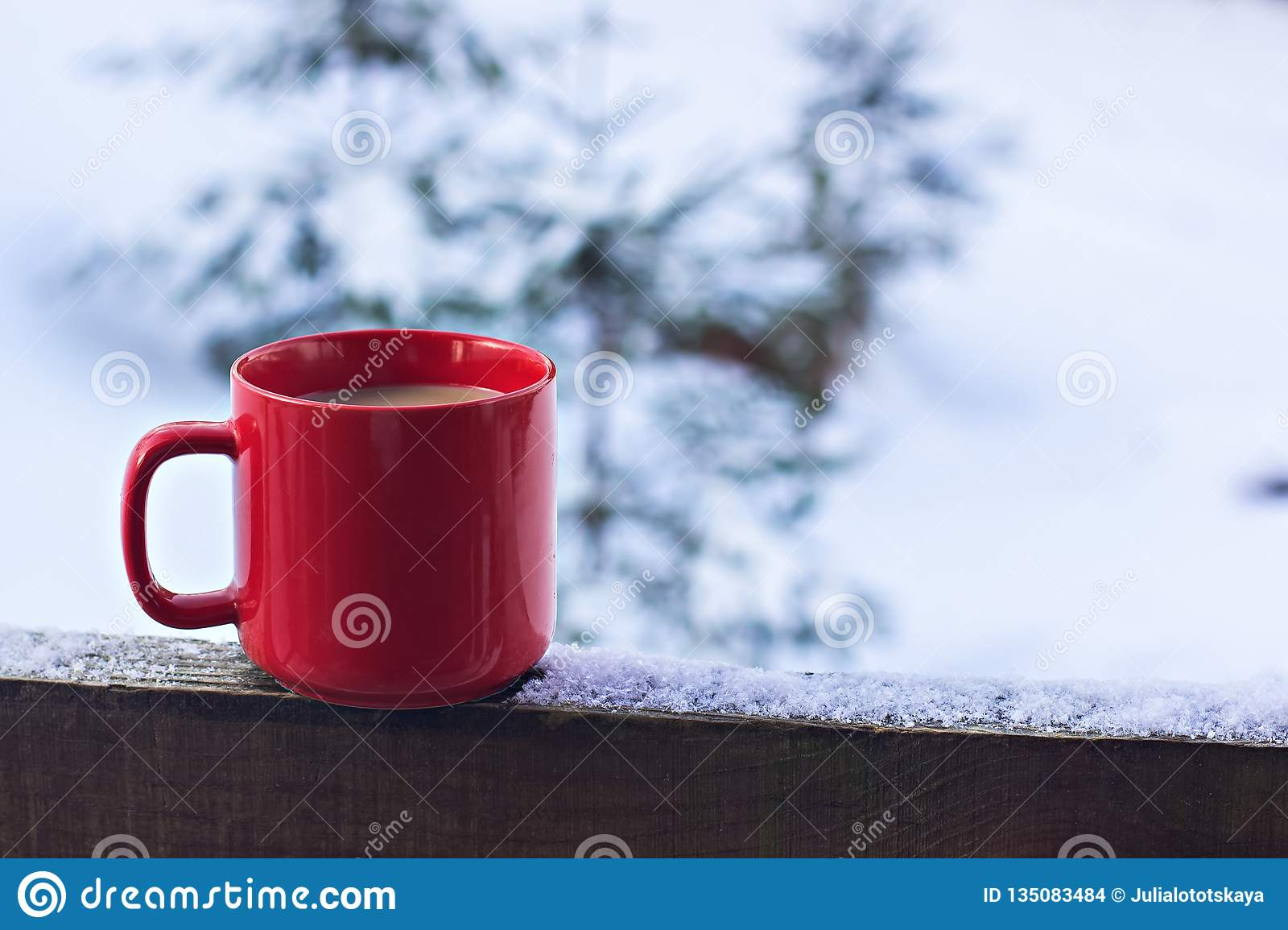 Cup with coffee, tea on the background of the winter landscape