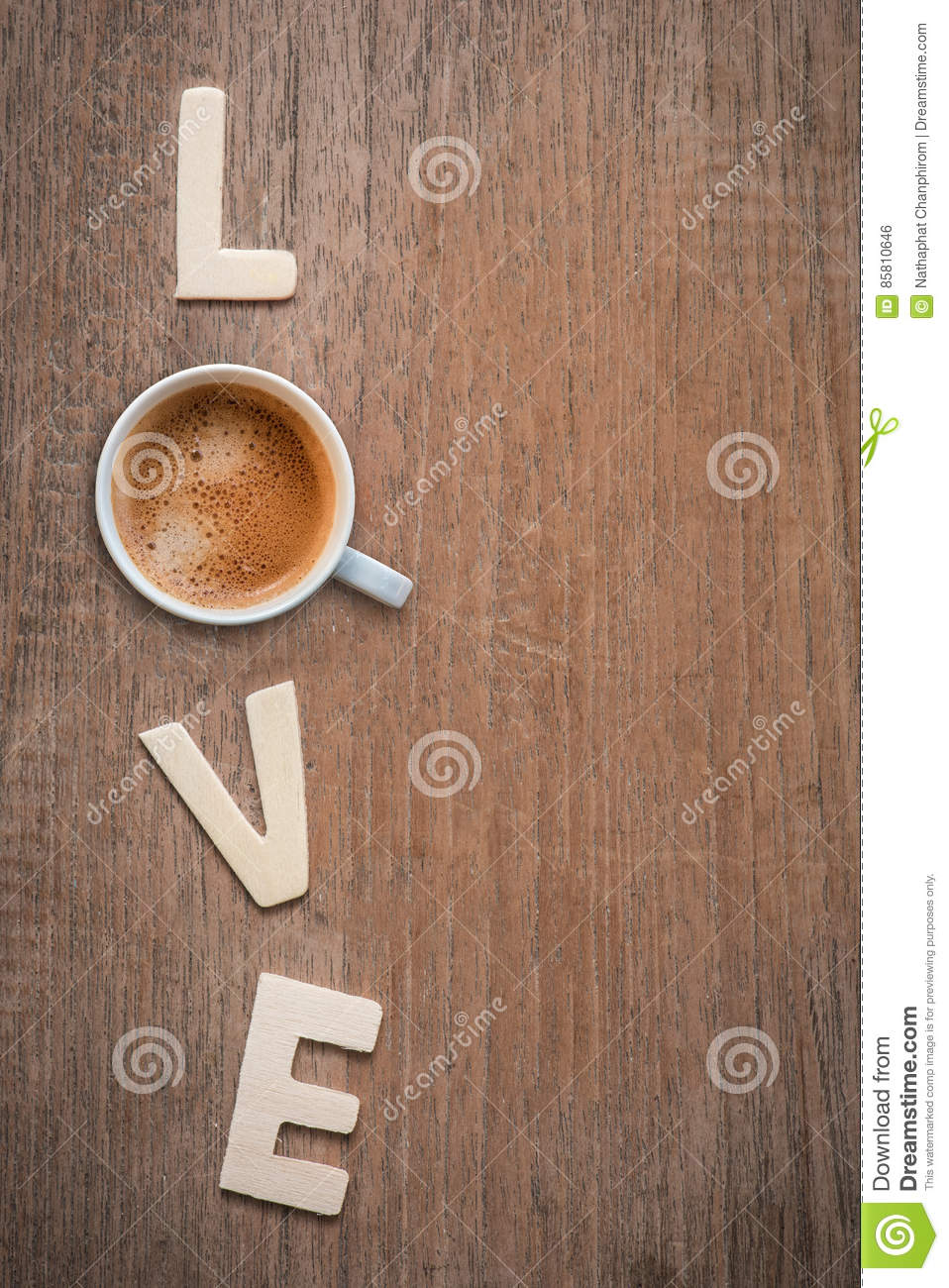 cup of coffee with wooden letters love