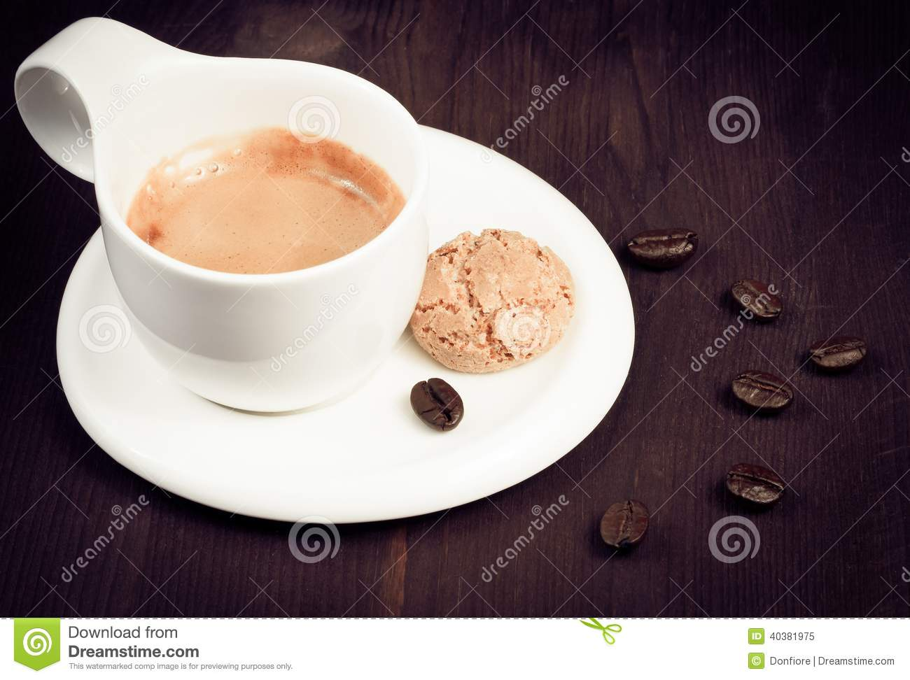... Photo: Cup of espresso coffee and biscuit near coffee beans, old style