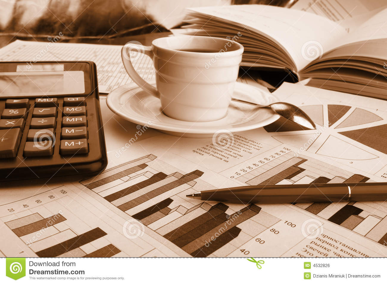 Cup of fragrant coffee on a morning paper business royalty for Coffee business