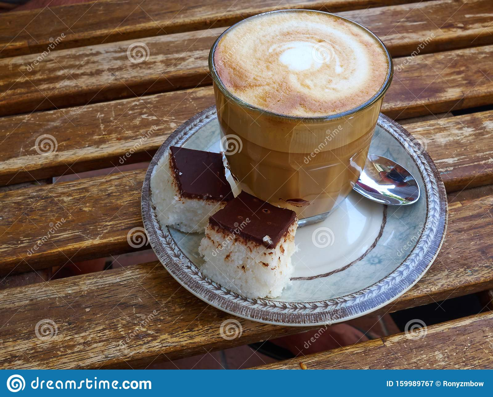 Cup Of Fresh Cappuccino Coffee Latte Served With Coconut Cake Stock Image Image Of Bakery Background 159989767