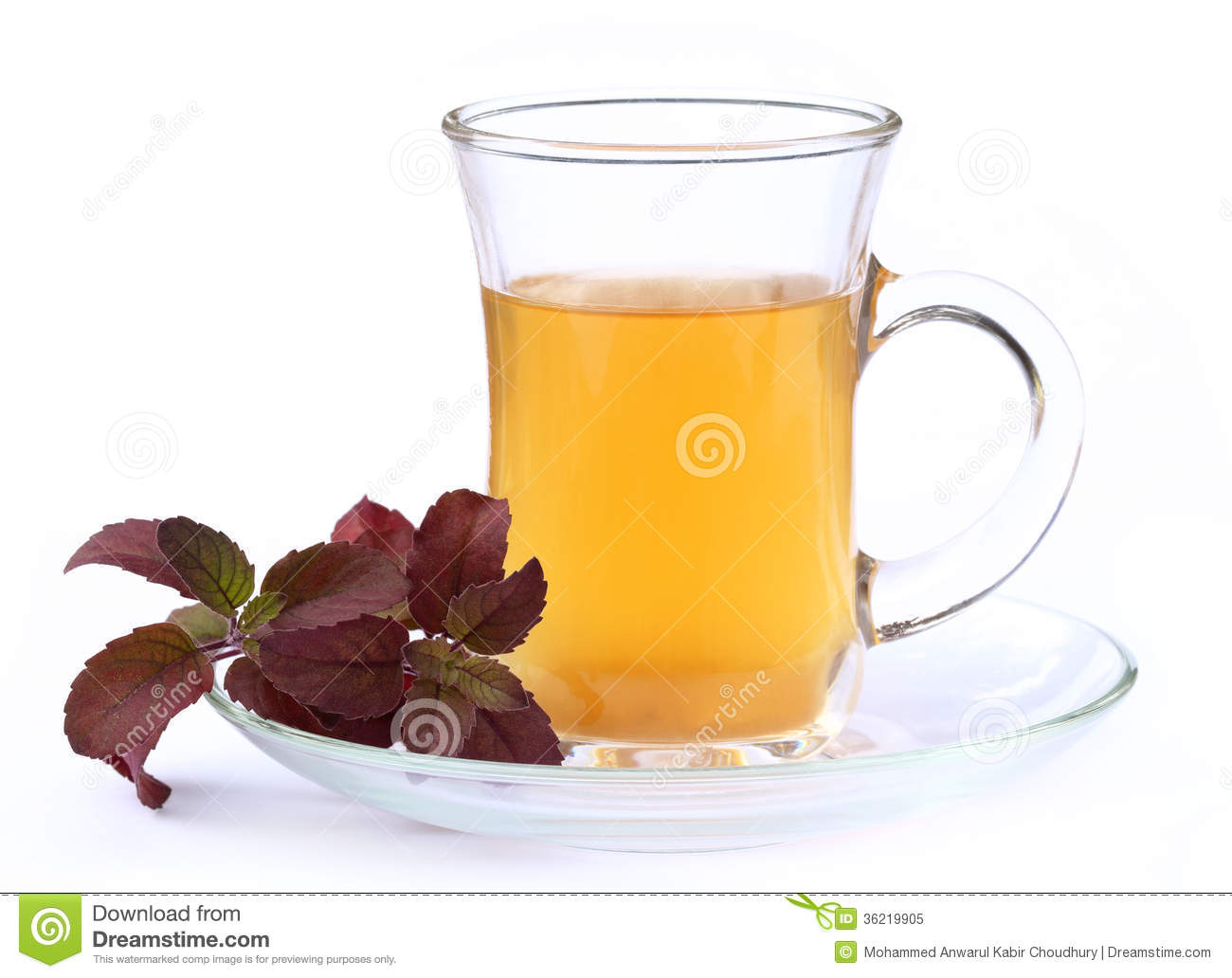 Cup of herbal tea with red tulsi leaves