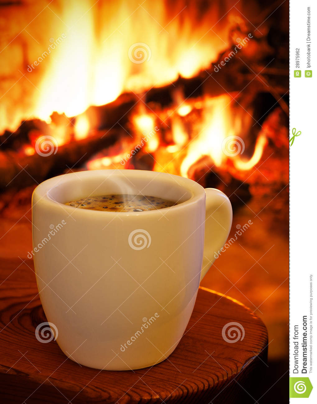 A Cup Of Hot Coffee In Front Of The Fireplace Stock Photo
