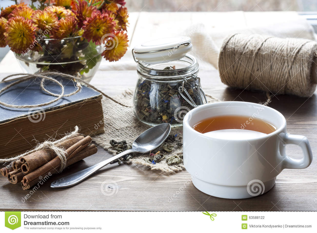 Cup Of Hot Tea With Books Tea Leaves And Flowers On Wooden Table Vintage Still Life Stock Photo Image Of Branch Book 63588122