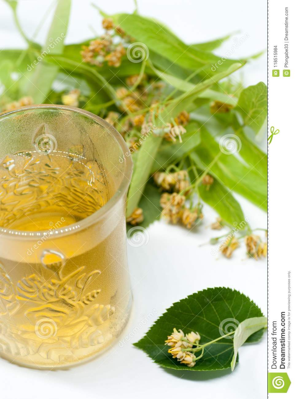 Cup With Linden Tea And Linden Flowers On White Homeopathy