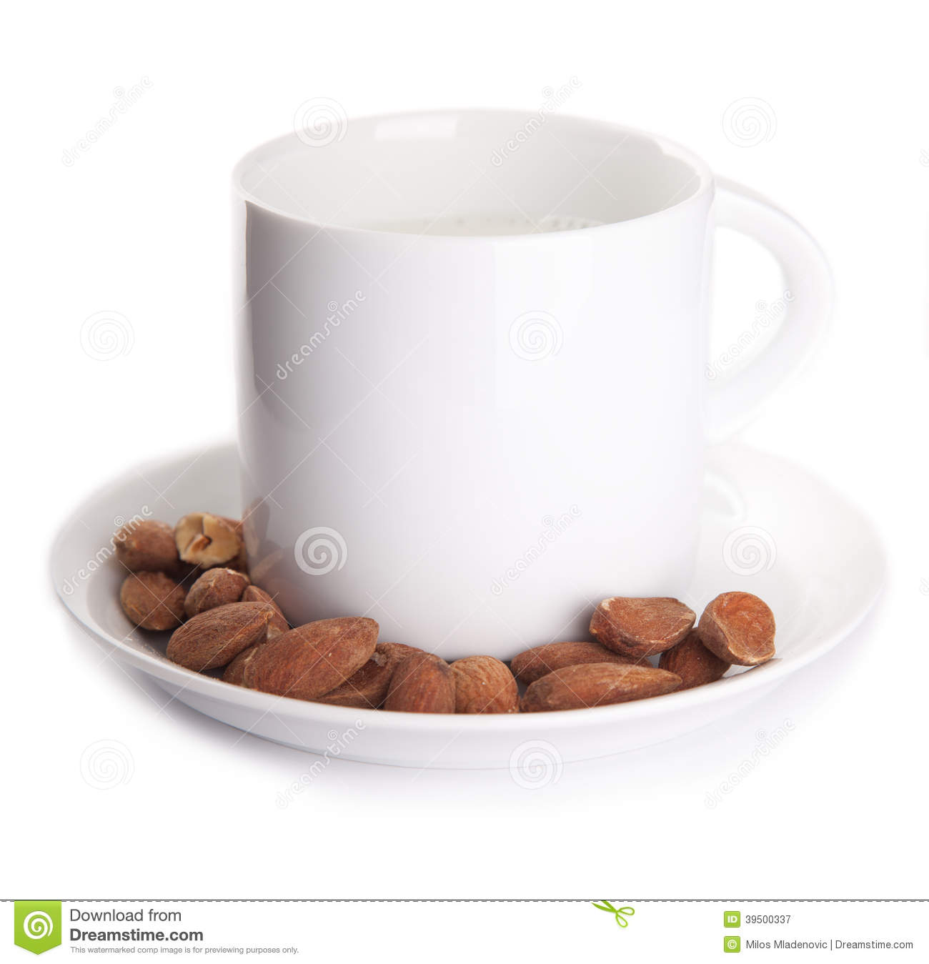A cup of milk with almonds isolated