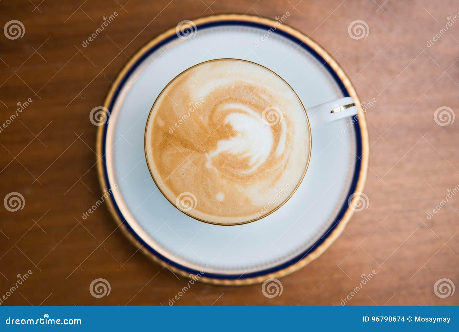 Cup of mocha with milk foam in,cafe