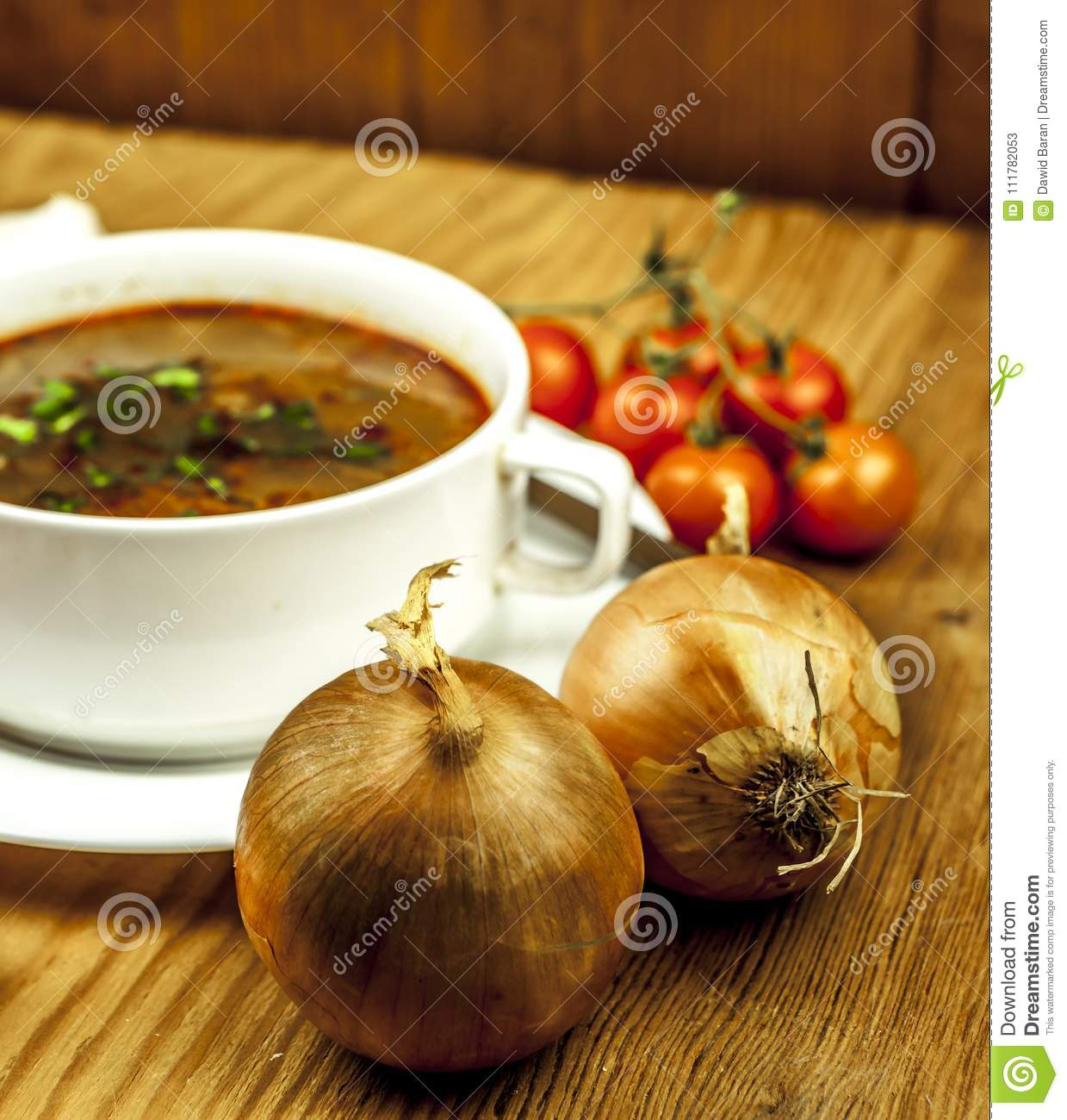 Cup of onion soup with two onions
