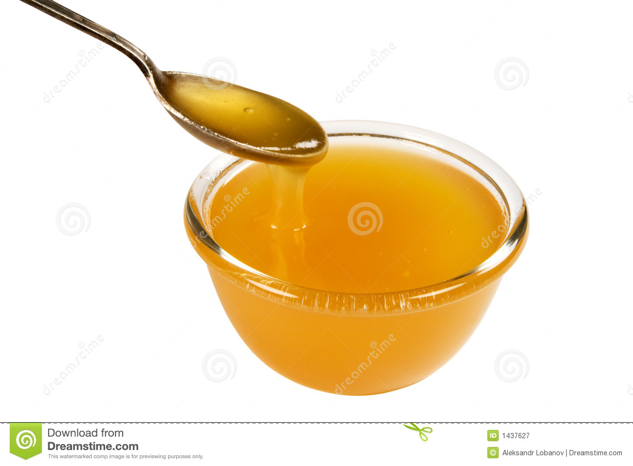 A Marble In A Cup Of Honey : Cup and spoonful of honey royalty free stock photography