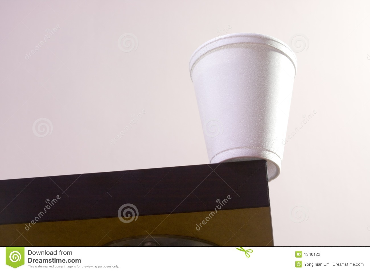 Cup On Table Edge Stock Photography - Image: 1340122