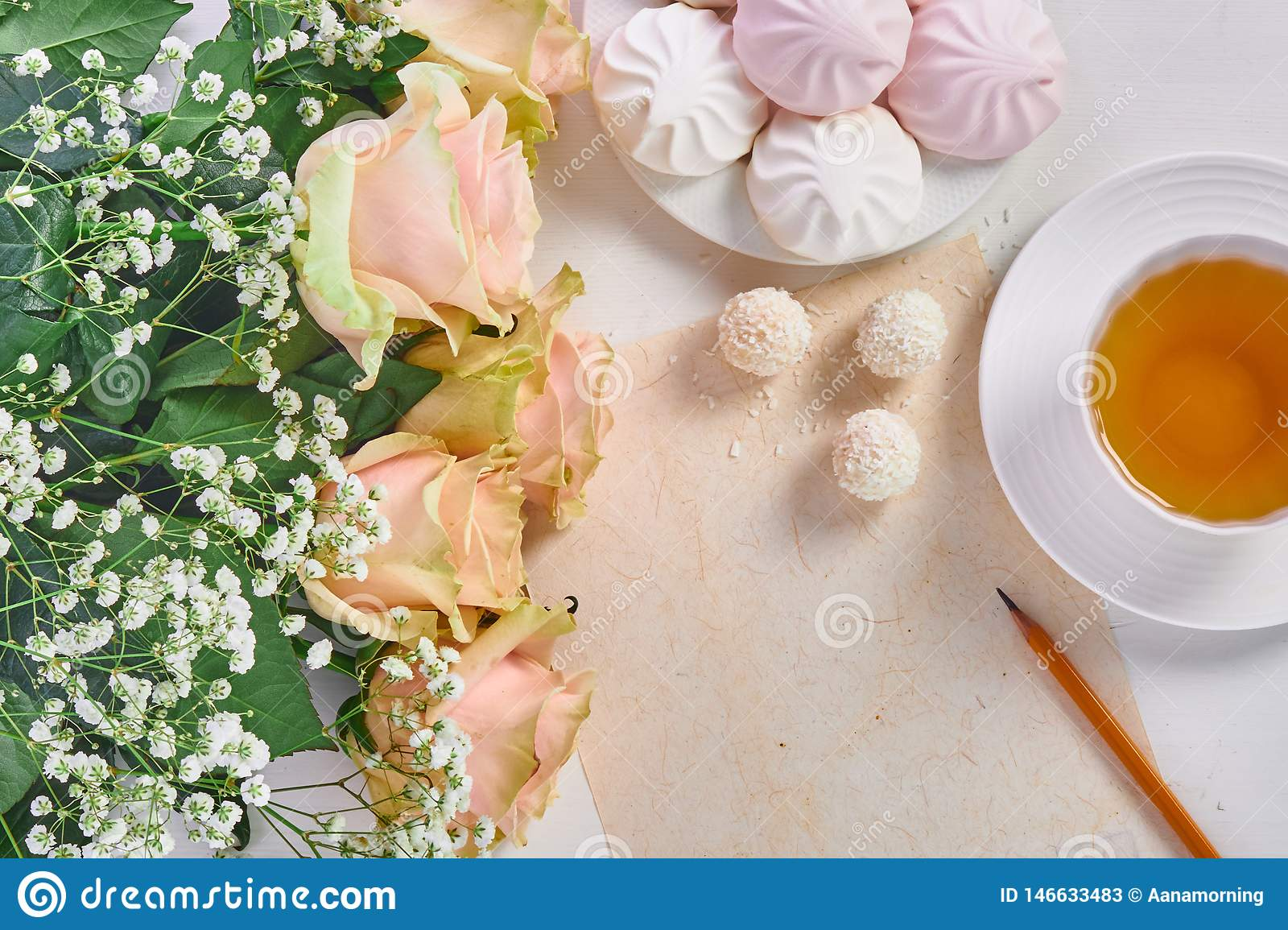 Mother's day. Cup of tea, bouquet of roses and sweets