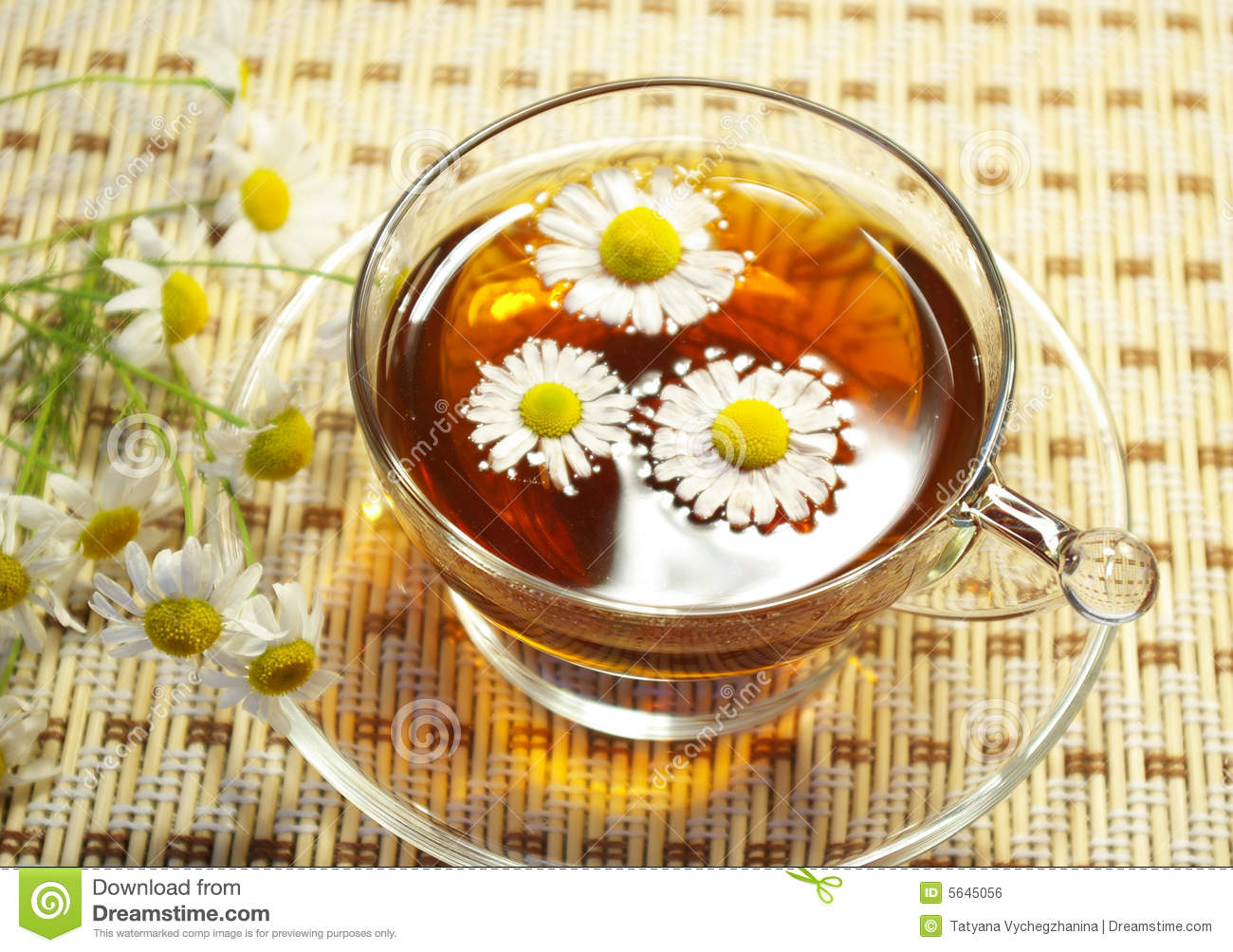 Cup of tea and chamomile blossoms