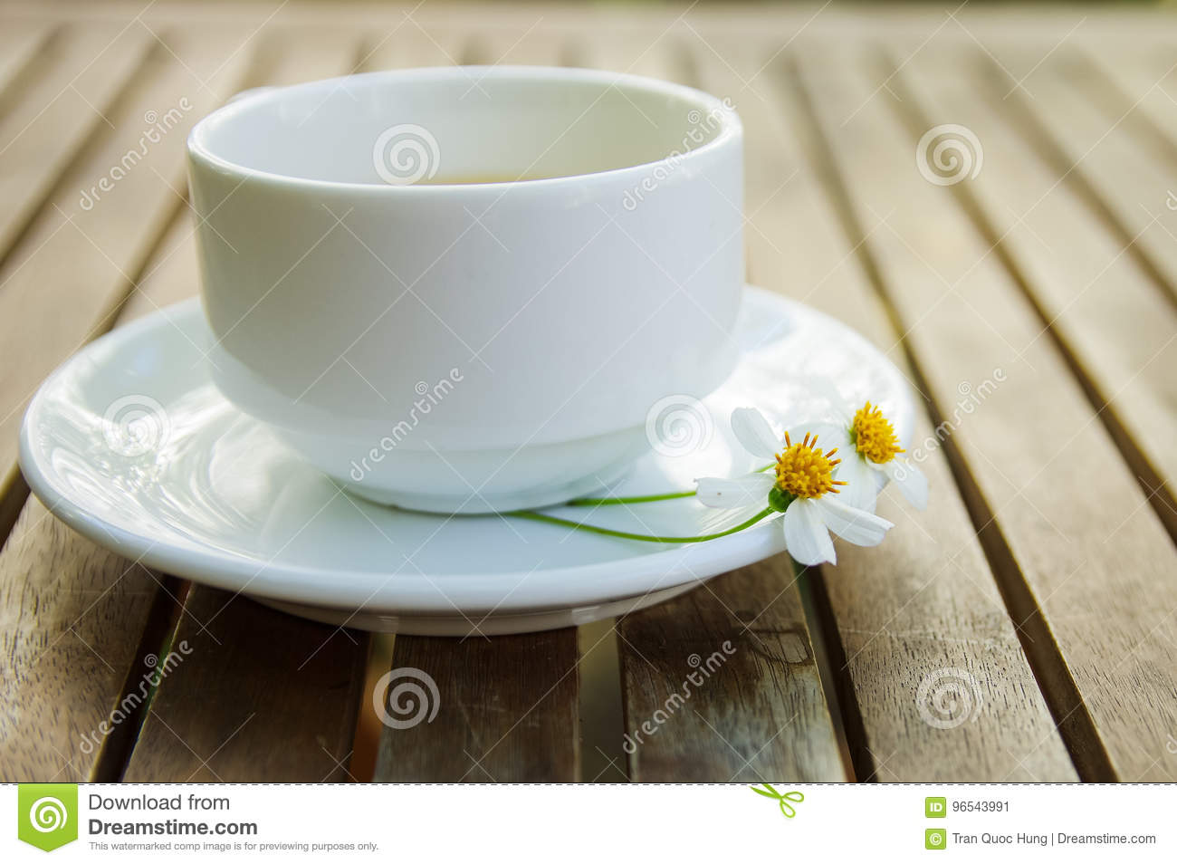 Cup Of Tea Couple Of Wild Daisy Flower On A Ceramic Dish On Wo