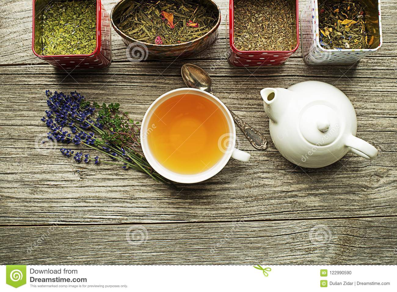 Cup of tea with dry tea and herbs collection