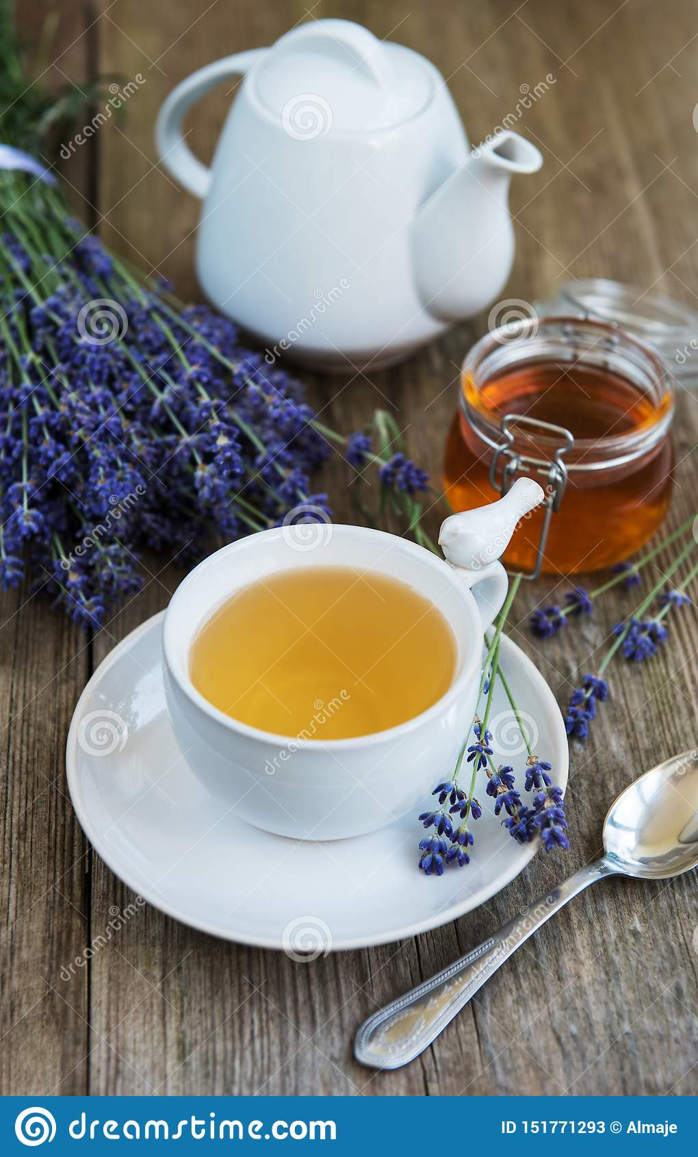 Cup of tea and honey with lavender flowers
