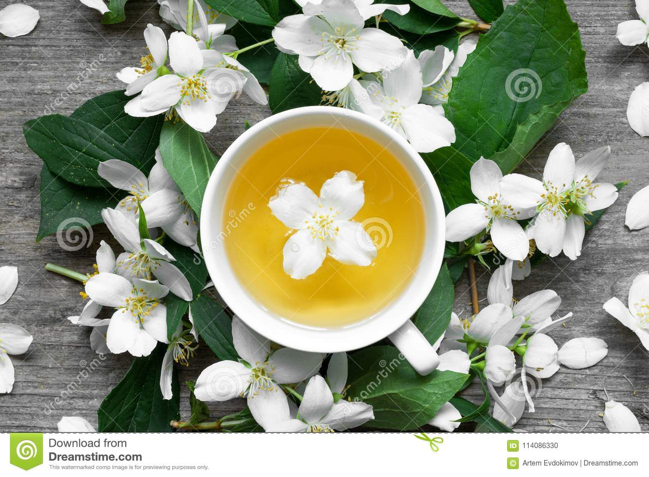 Cup Of Tea With Jasmine Flowers On A Wooden Background Stock Photo