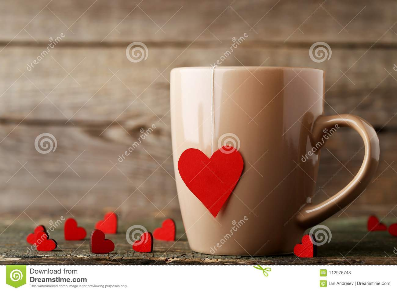 Cup of tea with red hearts