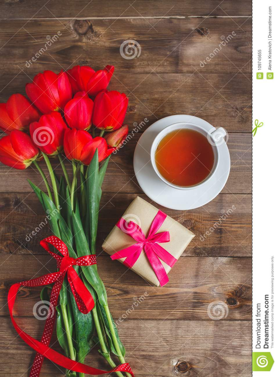 A Cup Of Tea Red Tulips Pattern And Gift Box On Wooden Background