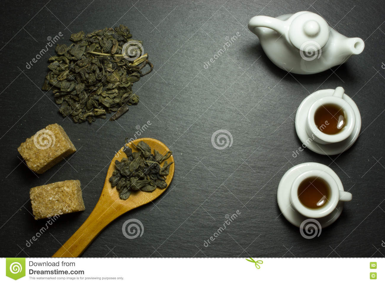 Cup and tea in a wooden spoon