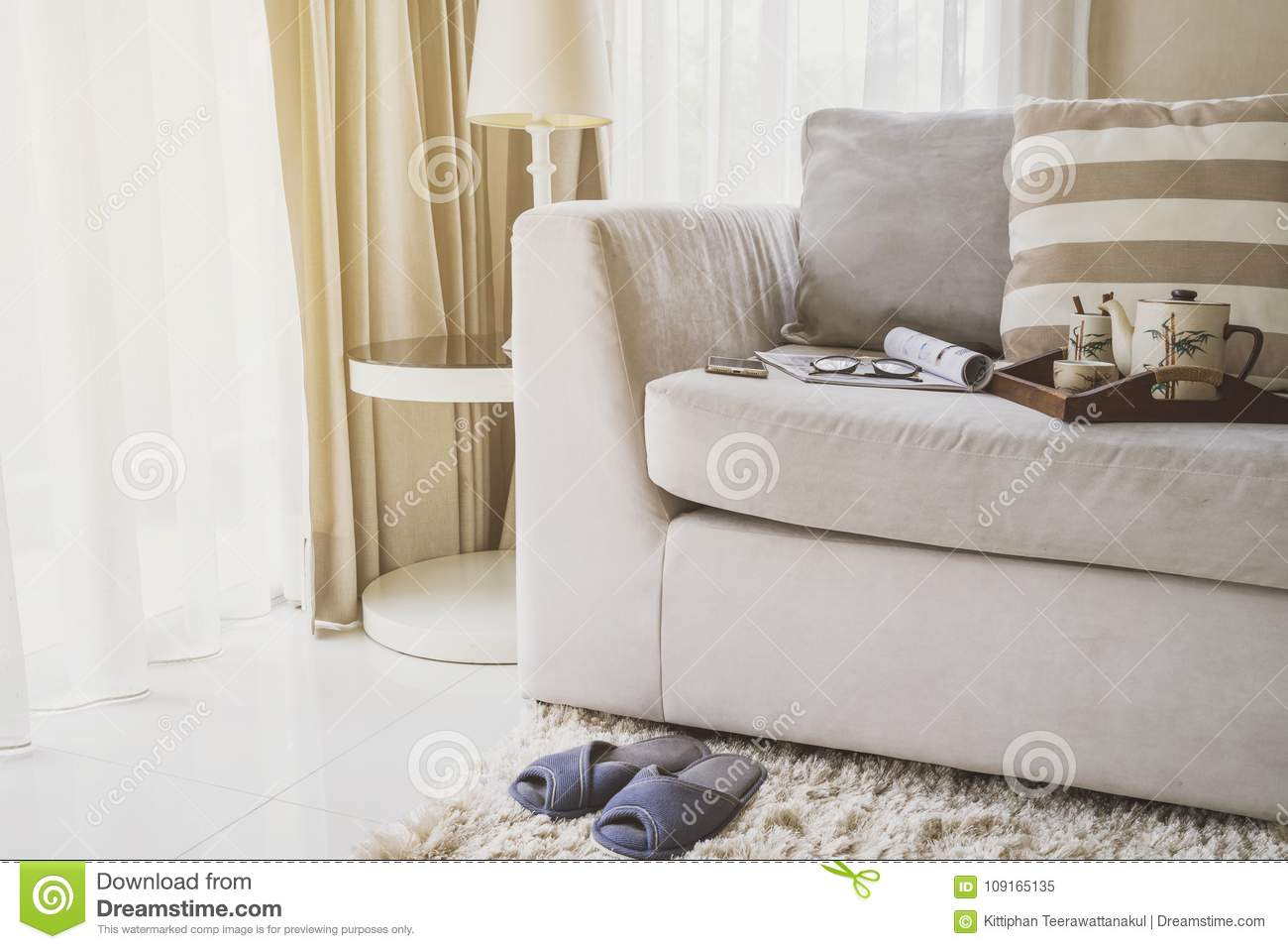 Cup Of Tea On Wooden Tray On Sofa In Living Room Stock Image - Image ...