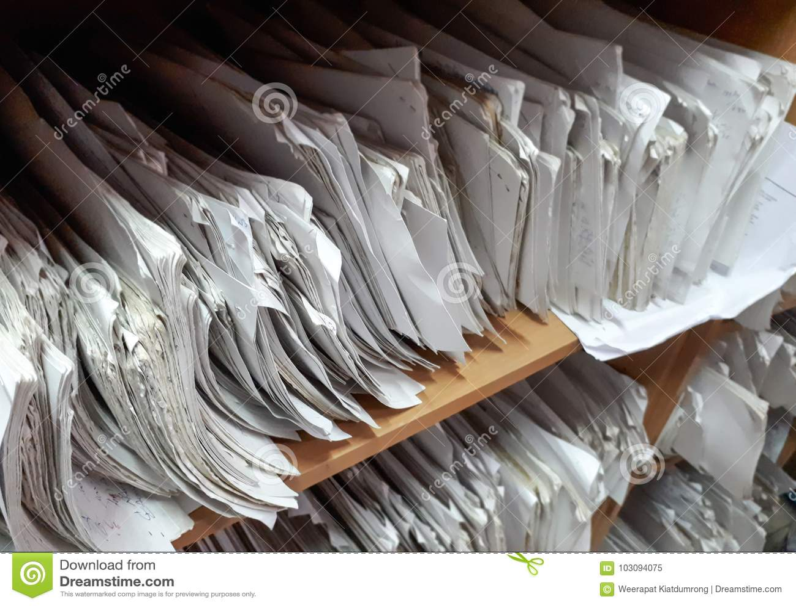 A cupboard full of paper files