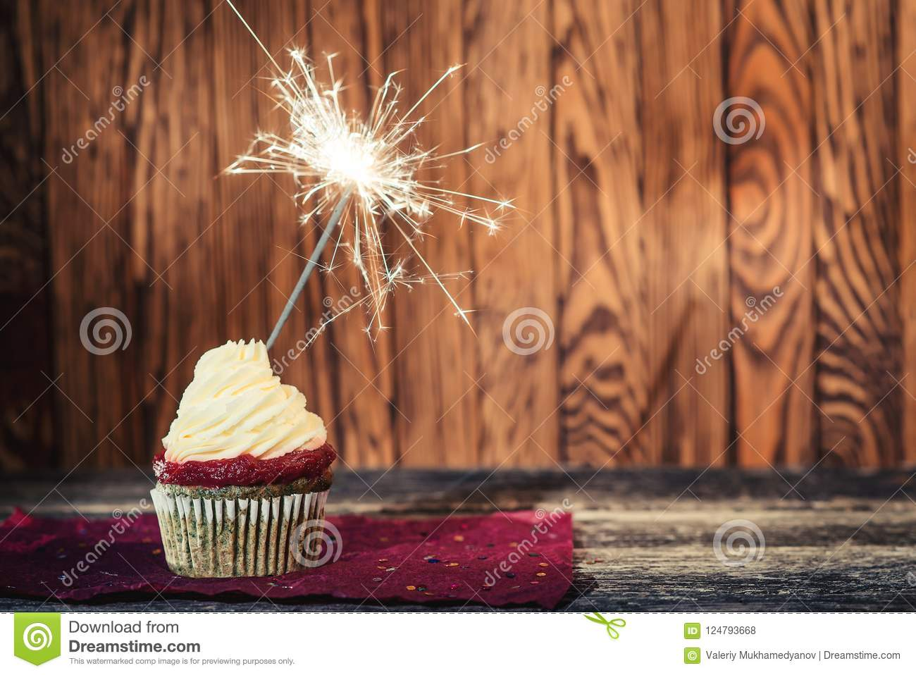 Birthday Cake With Sparkler On The Dark Wooden Background Delicious