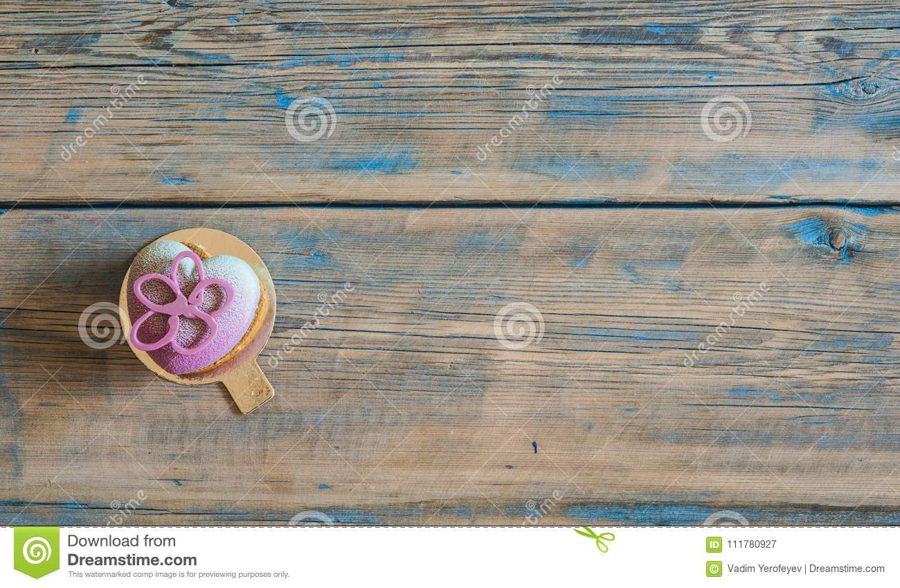 Cupcake on wooden table.