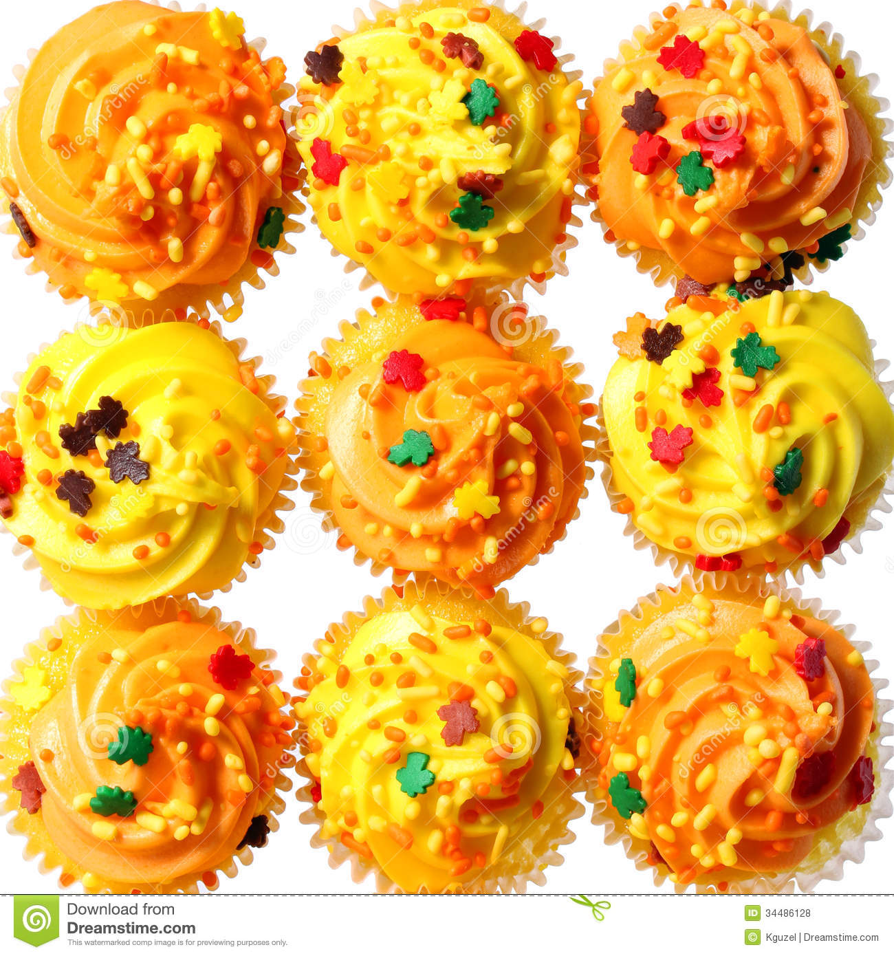 Cupcakes With Yellow And Orange Frosting And Colored