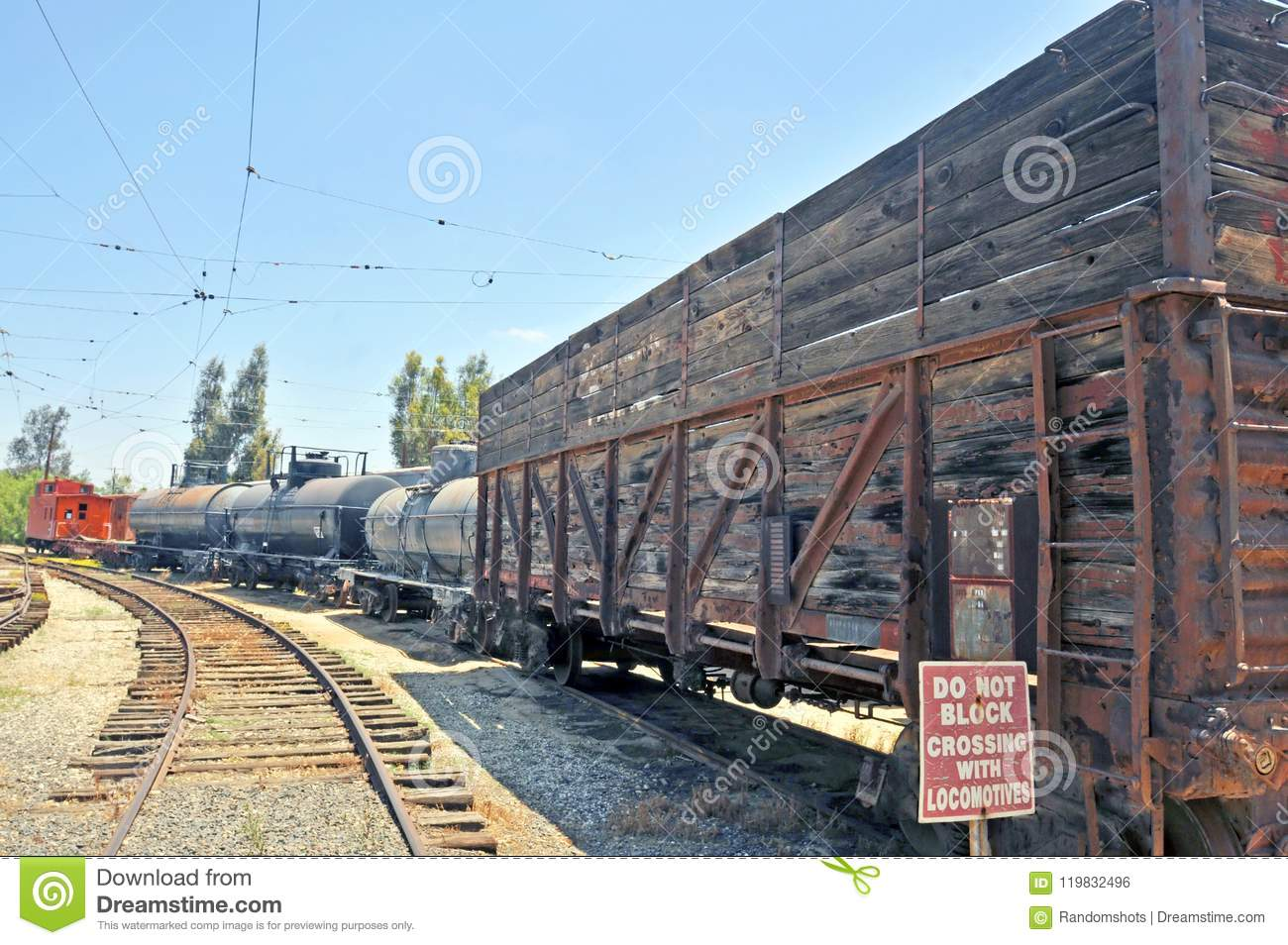 Vintage Caboose, Tanker Cars, & Cattle Car Stock Photo - Image of