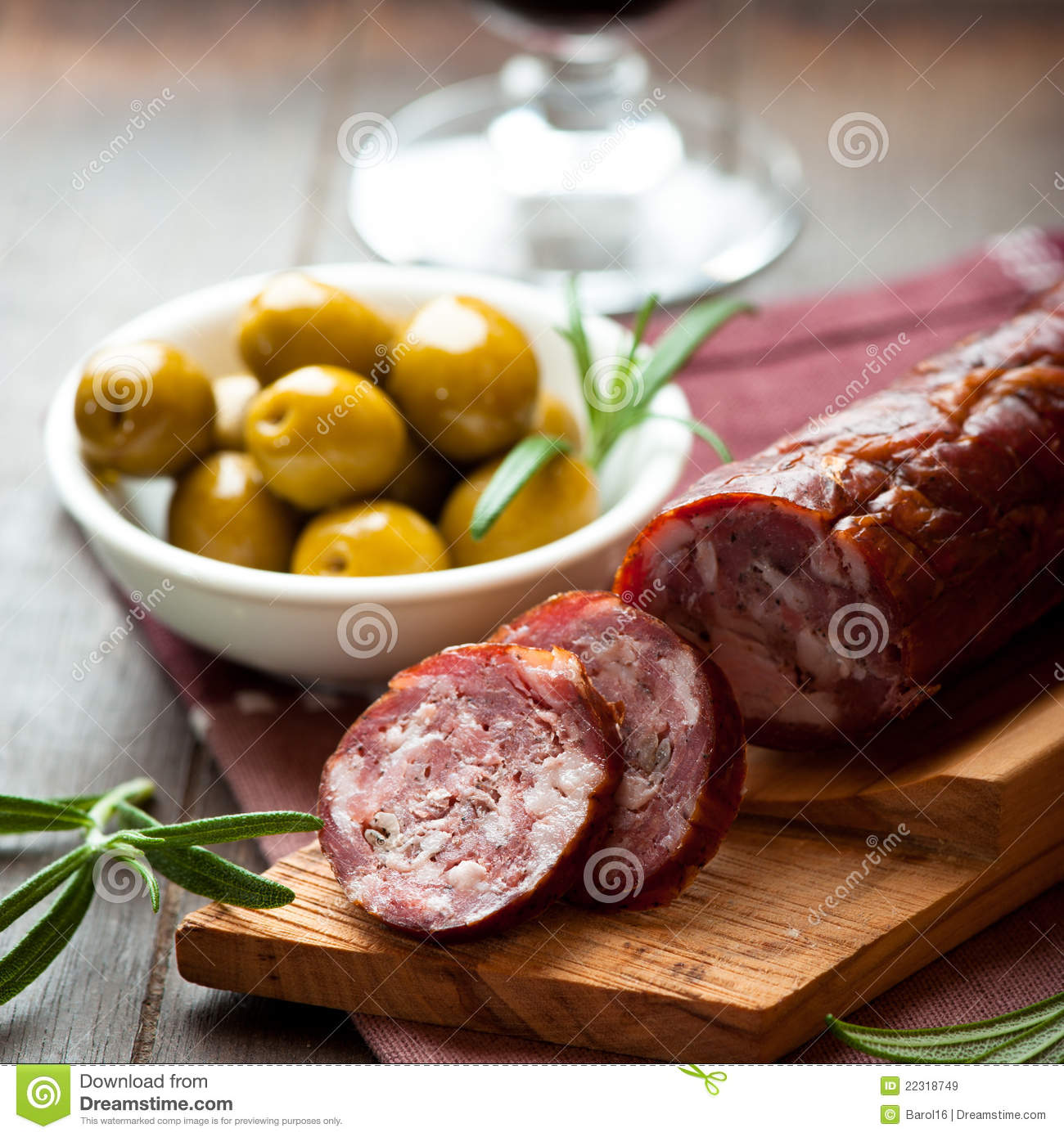 Cured dry sausage on chopping board