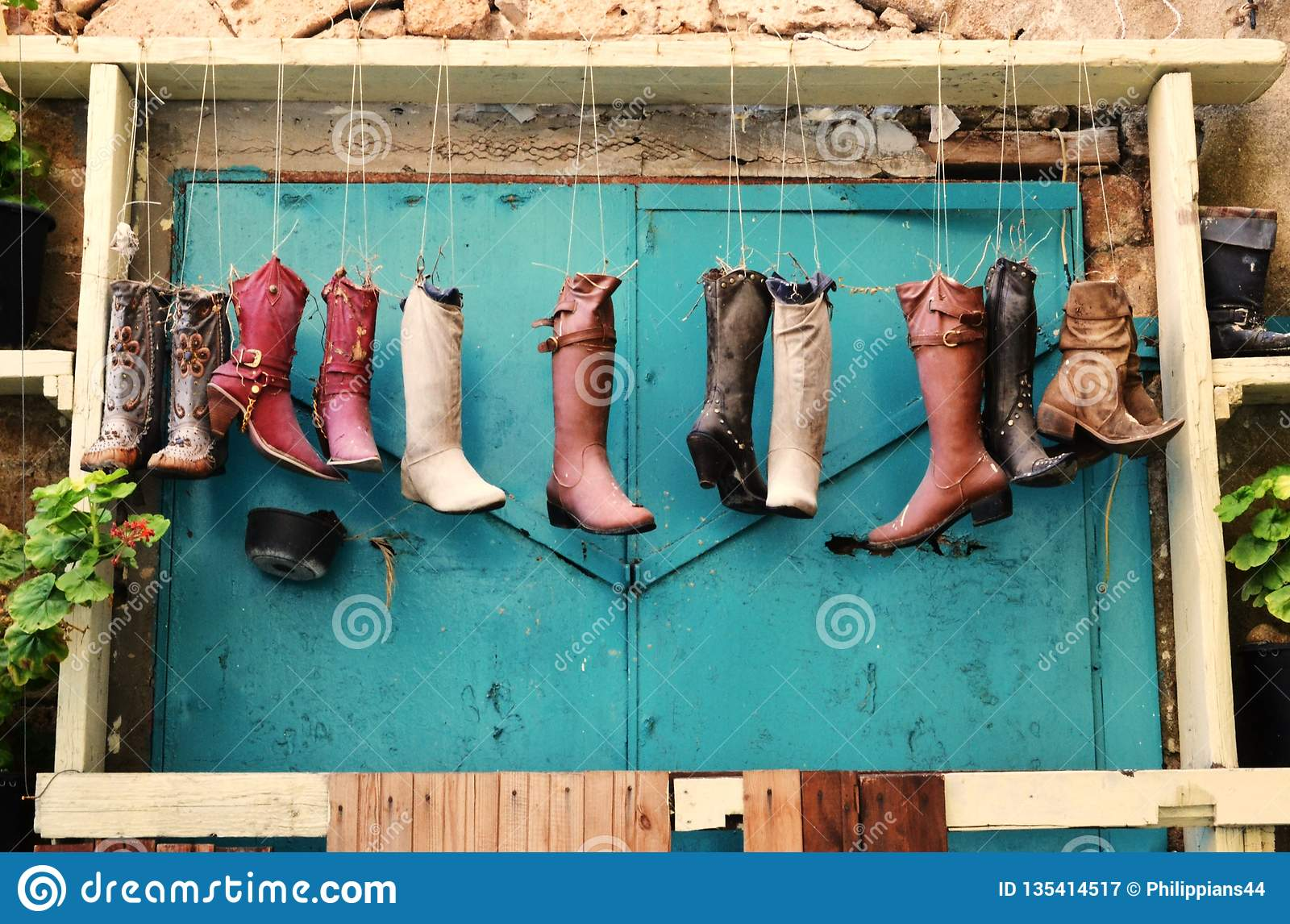 Curiosities in Acre, Akko, boots and shoes, handbags, as flower pots, exterior design and decoration, in Israel