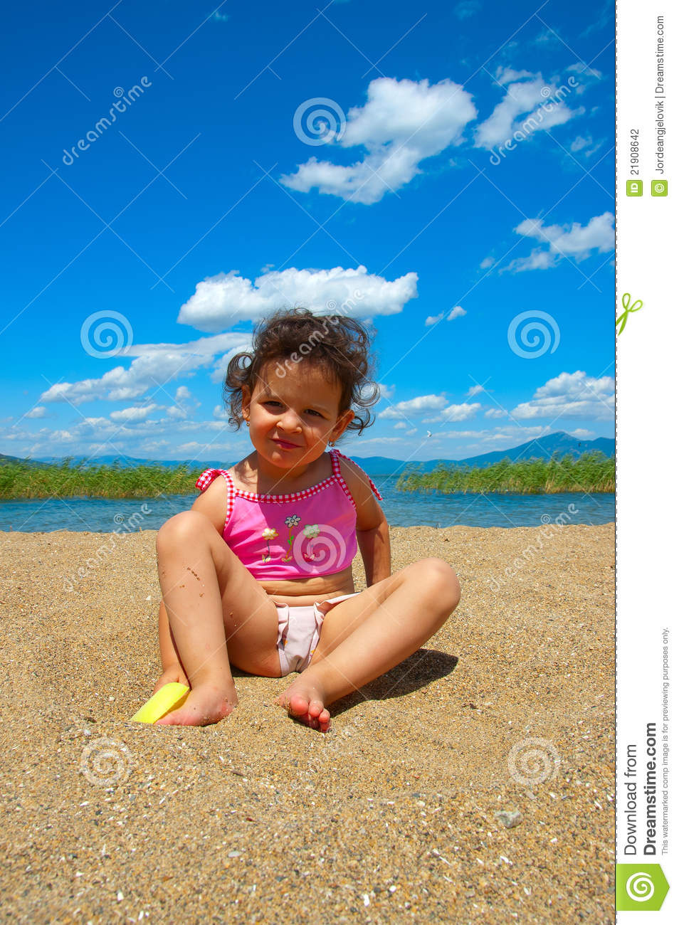 Curious Baby Girl On The Beach Stock Photography