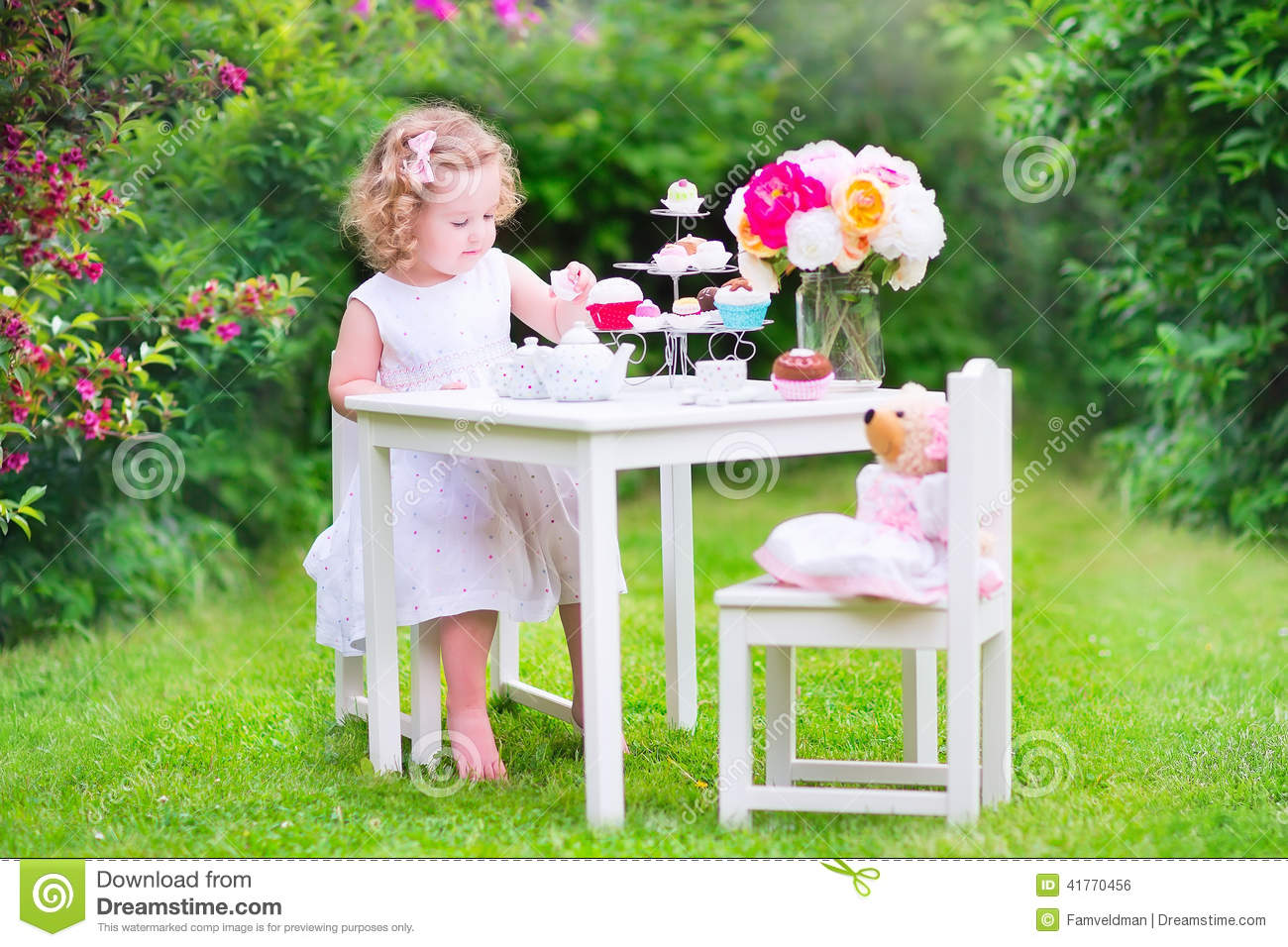 Curly Adorable Toddler Girl Playing Tea Party With Doll