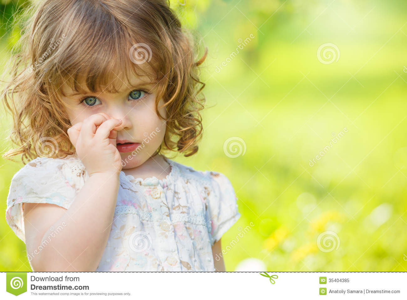 Curly Girl In A Summer Garden Royalty Free Stock Photo