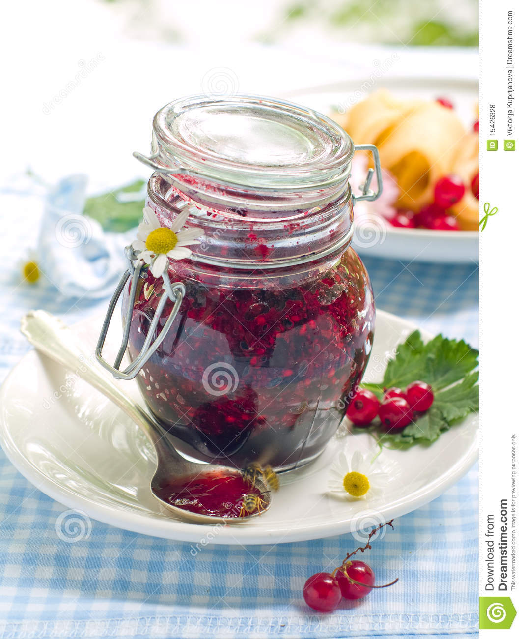 Red currant and black currant jam in jam-jar.