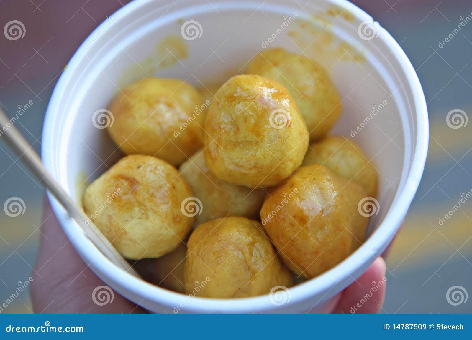 Curry fish balls at an asian chinese food market royalty for Chinese fish balls