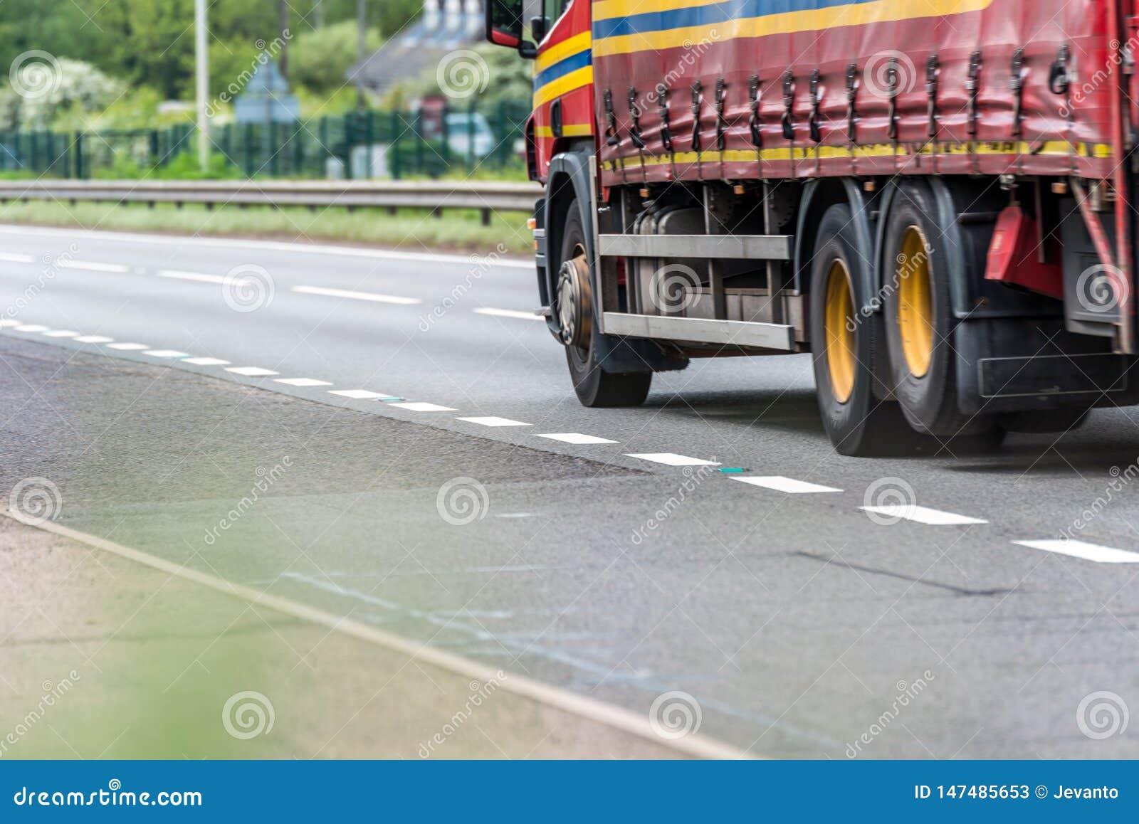 Curtain side truck on uk motorway in fast motion