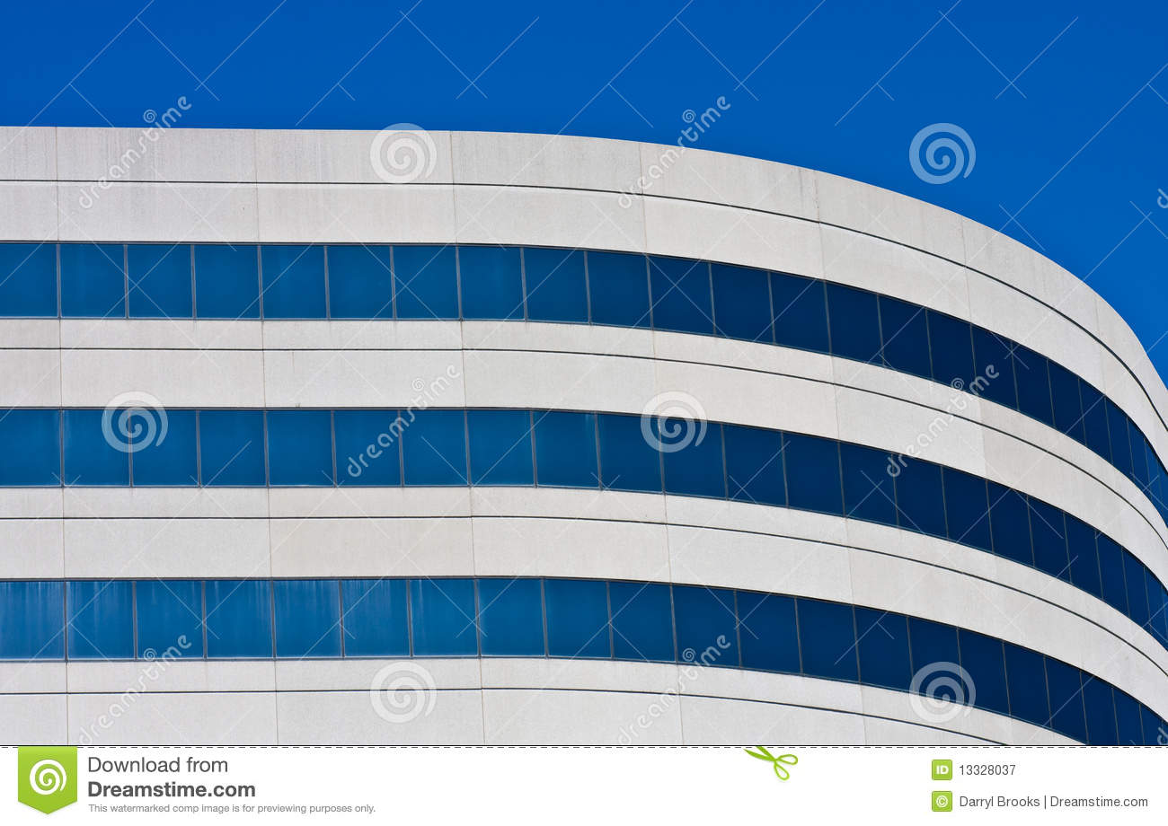 Download A Curved Concrete And Blue Glass Office Building Stock Image - Image of architecture, modern: 13328037