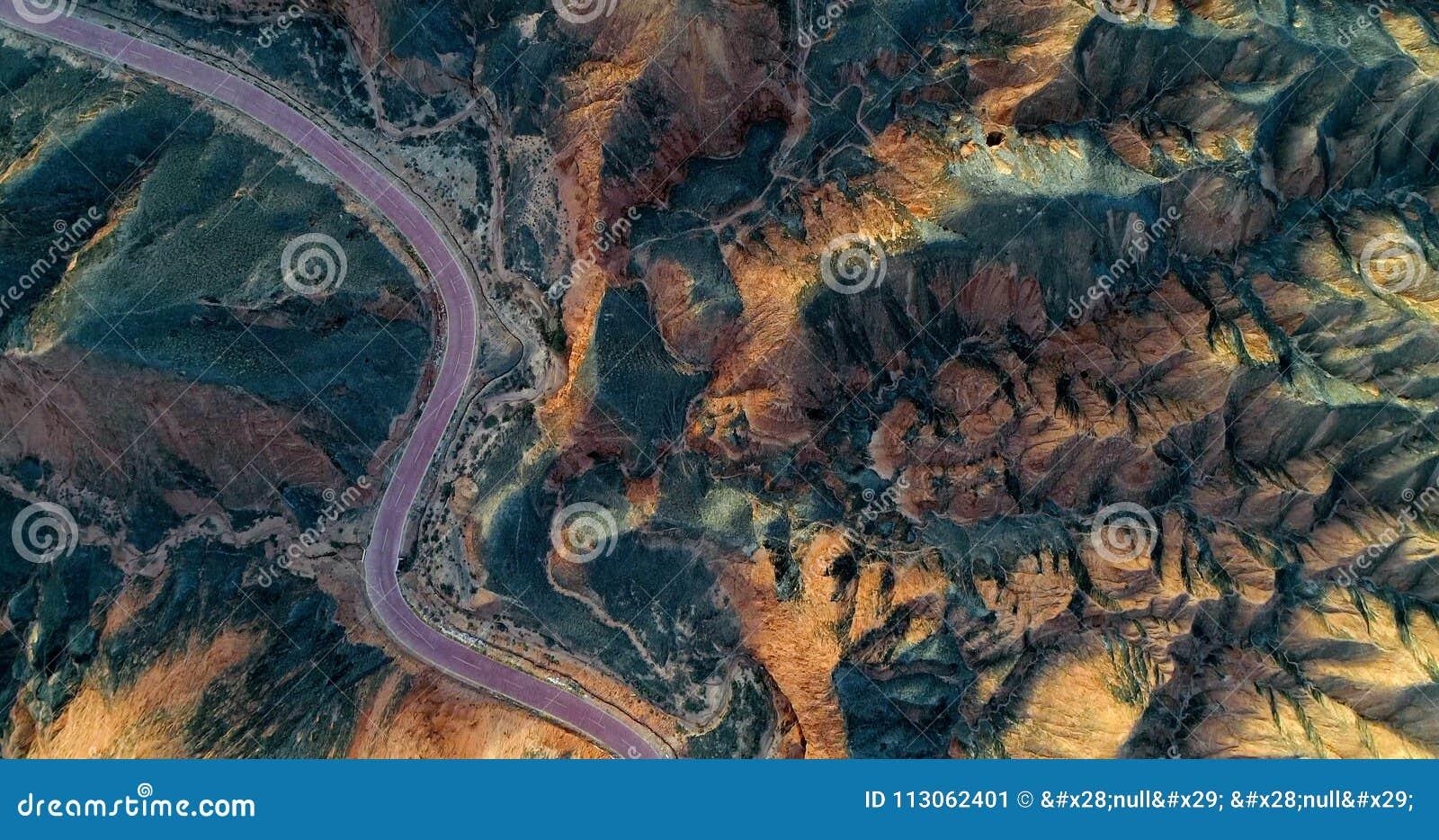 Curved road passing through a unique mountain landscape