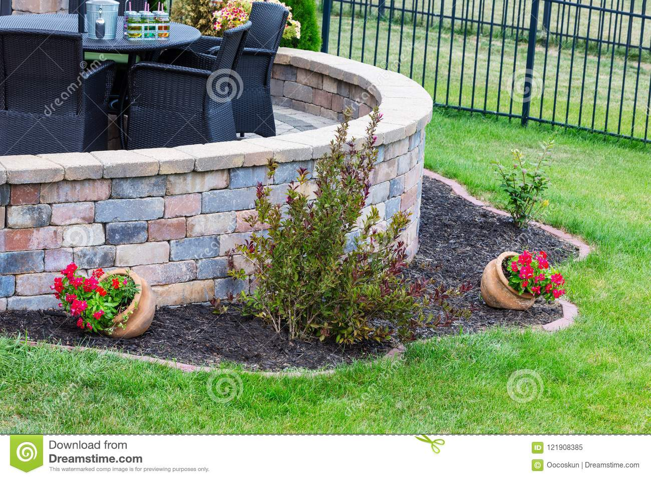 Curved Round Brick Wall On An Outdoor Patio