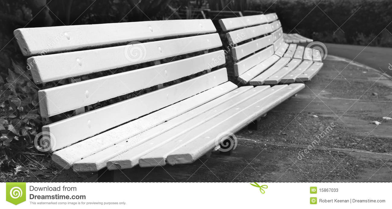 Curved Row of Park Benches Trimed