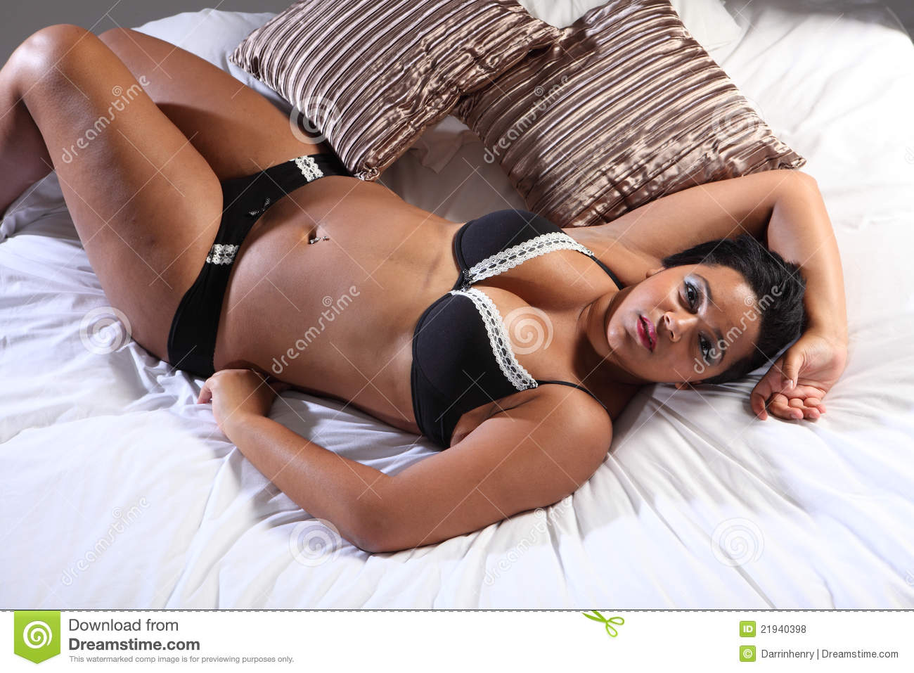 curvy african american woman in bed lingerie stock photo - image of