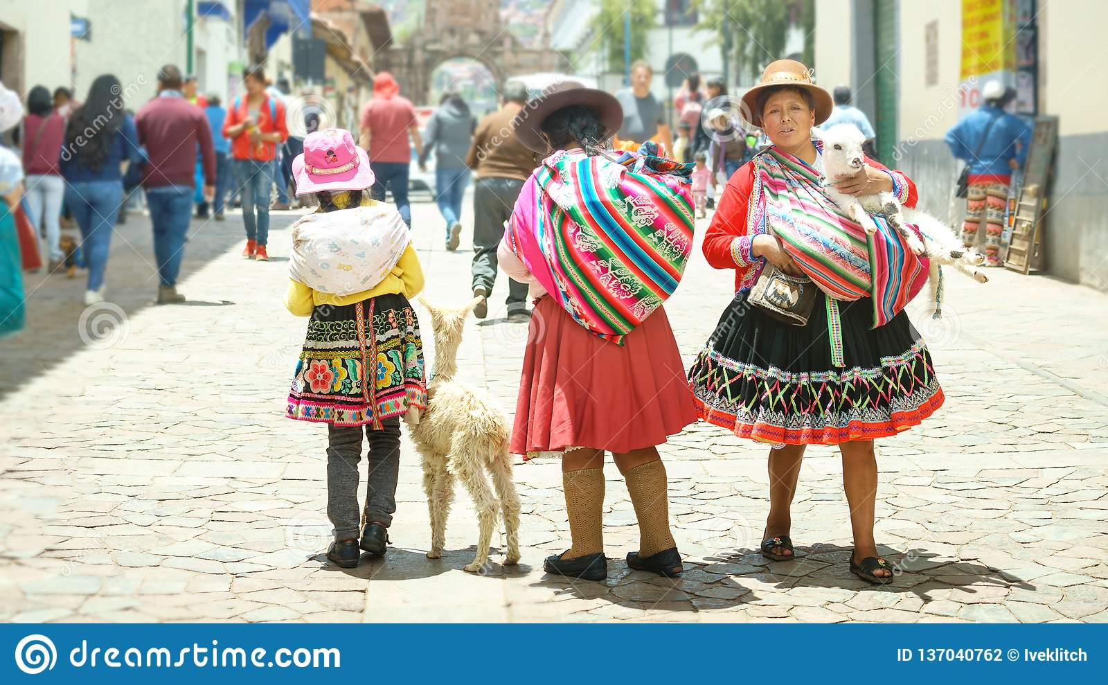 Cusco Peru 01 03 2019 Peruvian Women And Girl In Traditional Dresses And Small Llama On The Street Of Cusco Peru Editorial Photography Image Of Destination Landscape 137040762