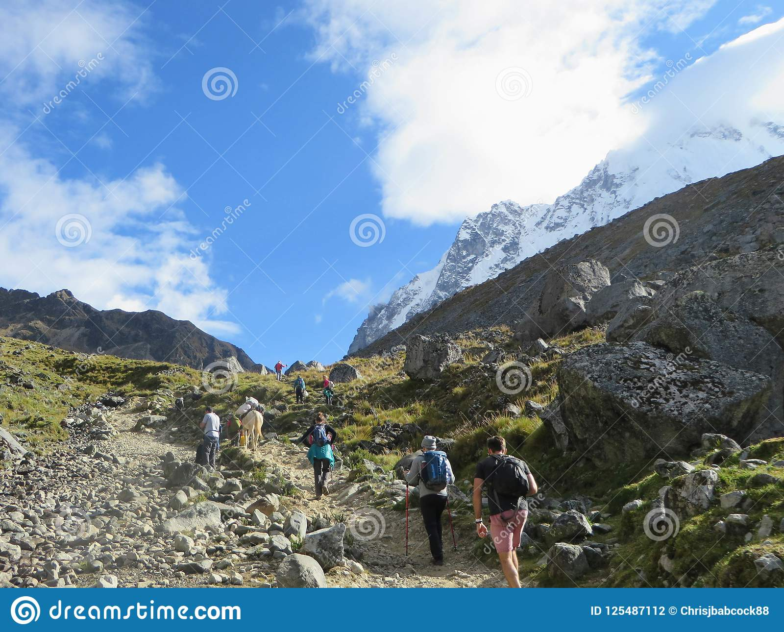 Cusco Province, Peru - May 8th, 2016: A young group of international hikers, led by their local Inca guide, navigate the Andes mo