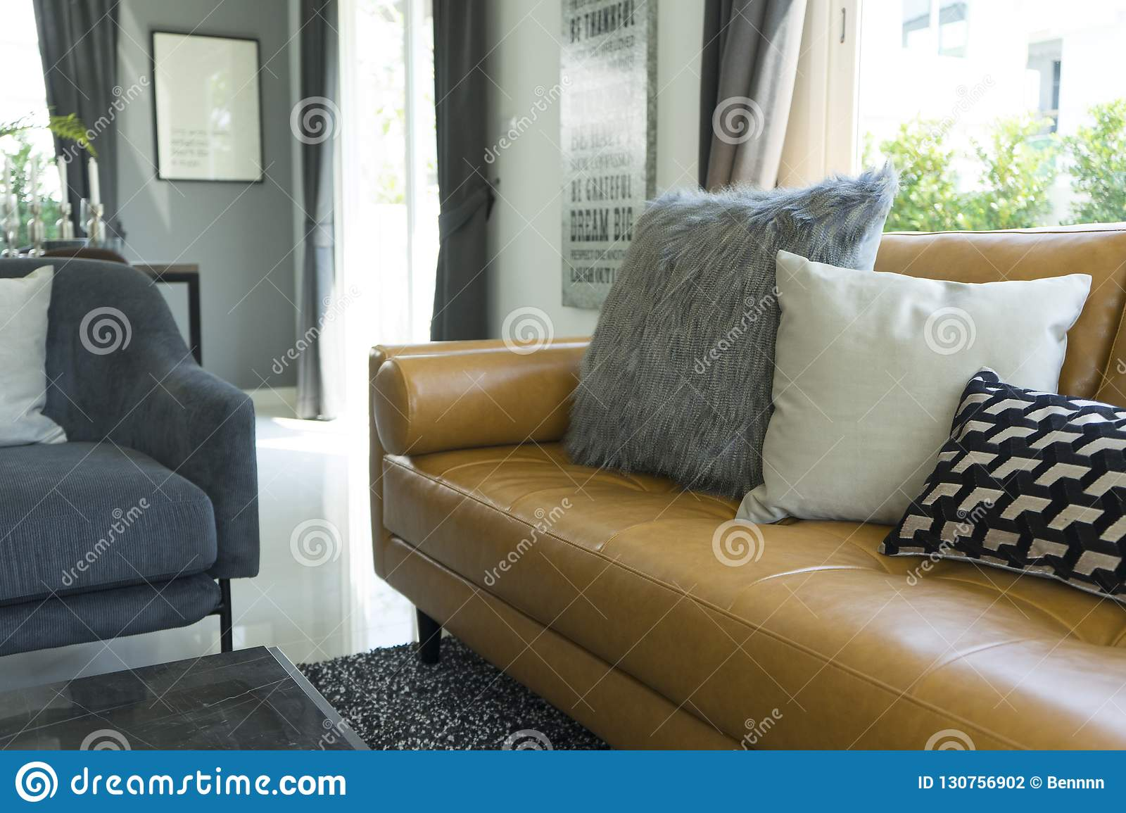 Groovy Cushion On Brown Leather Sofa In Living Room Stock Photo Machost Co Dining Chair Design Ideas Machostcouk